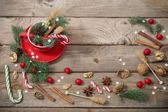 Christmas decorations in red cup on wooden background royalty free stock photo