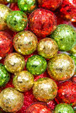 Christmas decorations, red, green and gold ornaments Stock Images