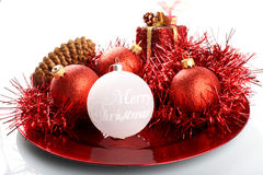 Christmas decorations on red plate Royalty Free Stock Images