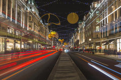 Christmas decorations in Regent's Street. London. LONDON - NOVEMBER 26th 2015: This year's Regent Street Christmas lights feature shimmering golden sequins, cogs Royalty Free Stock Photos