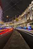 Christmas decorations in Regent's Street. London. LONDON - NOVEMBER 26th 2015: This year's Regent Street Christmas lights feature shimmering golden sequins, cogs Royalty Free Stock Photography