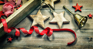 Christmas decorations, ribbons and golden bell. Vintage style Royalty Free Stock Photography