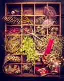 Christmas decorations, ribbons and vintage pair of scissors in Aged Wooden box. Top view Royalty Free Stock Photos