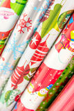 Christmas decorations - rolls of wrapping paper Stock Images