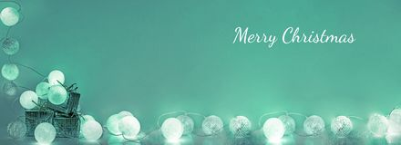 Christmas decorations. Round electric Christmas lights. With some decor elements. Horizontal banner Royalty Free Stock Photo