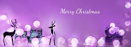 Christmas decorations. Round electric Christmas lights. With some decor elements. Horizontal banner Stock Photo