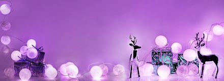 Christmas decorations. Round electric Christmas lights. With some decor elements. Horizontal banner Stock Image