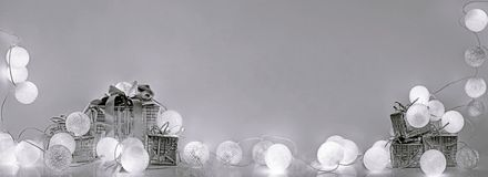Christmas decorations. Round electric Christmas lights. With some decor elements. Horizontal banner Stock Photography