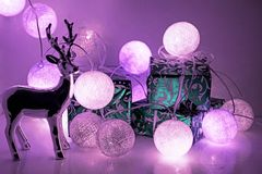 Round electric Christmas lights with some decor elements. Christmas decorations. Round electric Christmas lights with some decor elements stock photos