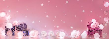Christmas decorations. Round electric Christmas lights with some decor elements. Horizontal banner stock photos