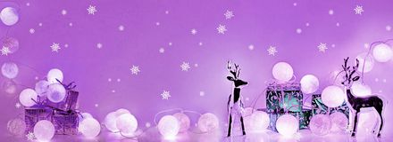 Christmas decorations. Round electric Christmas lights with some decor elements. Horizontal banner stock photography