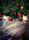 Christmas decorations on a rustic wood background, vintage retro Royalty Free Stock Image