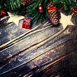 Christmas decorations on a rustic wood background, vintage retro Royalty Free Stock Photography