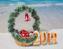 Christmas decorations on the sandy seashore and the inscription 2019- New Year`s card royalty free stock images