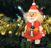 Christmas decorations Santa Claus. Christmas decorations on fir - close-up view Royalty Free Stock Images