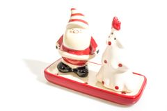 Christmas decorations, santa claus and a ceramic tree isolated i royalty free stock photos