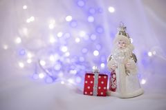 Christmas decorations with Santa Claus toy and present box. Stock Photo