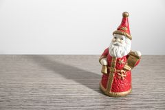 Christmas decorations, santa claus on a wood table royalty free stock photography