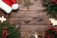 Christmas decorations with santa hat. On brown wooden table royalty free stock image