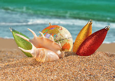 Christmas decorations and seashell on a beach Stock Photo