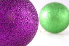 Christmas Decorations With Shallow Depth of Field. Purple and Green Glitter Christmas Decorations With Shallow Depth of Field Stock Photography