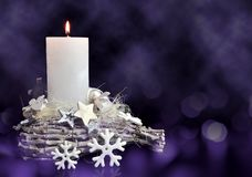 Christmas decorations in the shape star and snowflake with burning candle. stock images