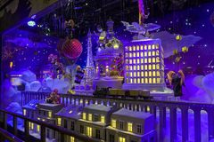 Christmas decorations in the shop window of a Parisian Printemps. PARIS, FRANCE - DECEMBER 12, 2017: Christmas decorations in the shop window of a Parisian Royalty Free Stock Images