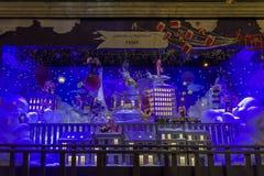 Christmas decorations in the shop window of a Parisian Printemps. PARIS, FRANCE - DECEMBER 12, 2017: Christmas decorations in the shop window of a Parisian Stock Images