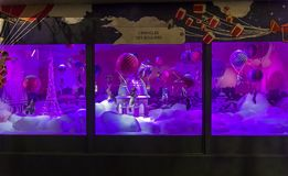 Christmas decorations in the shop window of a Parisian Printemps department store. stock photos