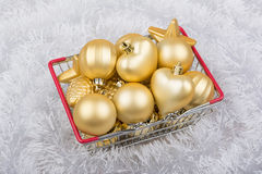 Christmas decorations in a shopping basket on white background Stock Photography
