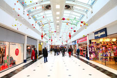 Christmas decorations in shopping mall. Festive Christmas decorations in a modern mall with people shopping.  Mander shopping centre, Wolverhampton, UK, 2013 Stock Photos