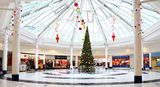Christmas decorations in shopping mall. Festive Christmas decorations and tree in a modern shopping centre / mall.   Mander shopping centre, Wolverhampton, UK Royalty Free Stock Photos