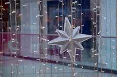 Christmas decorations. The silver star and lights - Christmas decorations in the mall Royalty Free Stock Photo