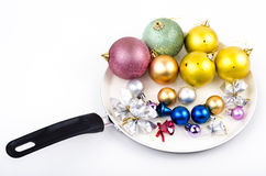 Christmas decorations on skillet Stock Images