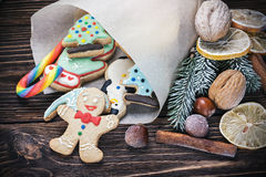 Christmas decorations. Smiling gingerbread men nestled in holiday the background of Christmas decorations Royalty Free Stock Photo