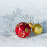 Christmas decorations on snow Royalty Free Stock Photo
