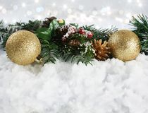 Christmas decorations in snow with bokeh lights background Royalty Free Stock Photography