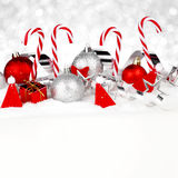 Christmas decorations in snow Stock Images
