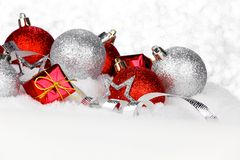 Christmas decorations in snow Stock Photos