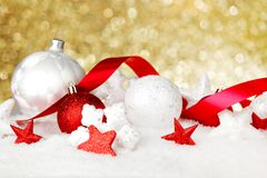 Christmas decorations in snow Royalty Free Stock Photos