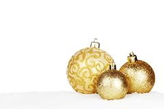Christmas decorations on snow Stock Images