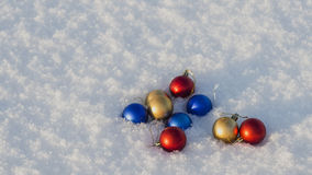 Christmas decorations in the snow. Frosty sunny day Royalty Free Stock Photos