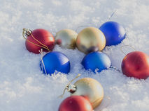 Christmas decorations in the snow. Frosty sunny day Royalty Free Stock Photo