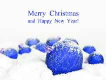 Christmas decorations in snow Stock Photography