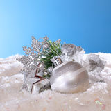 Christmas decorations in the snow. New Year composition royalty free stock photo