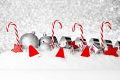 Christmas decorations on snow Stock Image