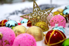 Christmas decorations on snow Stock Photos