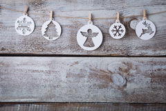 Christmas decorations (snowflake) hanging over wooden background.  royalty free stock photography