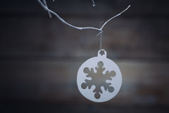 Christmas decorations (snowflake) hanging over wooden background stock image