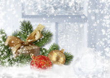 Christmas decorations on snowy window. Greeting card Stock Images